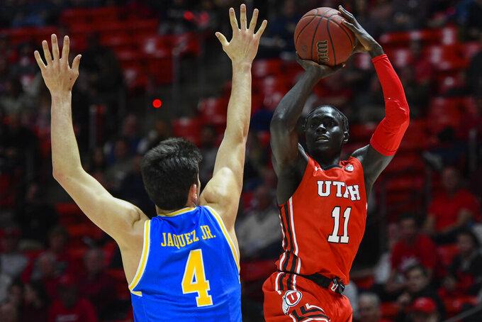 Utah guard Both Gach (11) shoots over UCLA guard Jaime Jaquez Jr. (4) during the second half of an NCAA college basketball game Thursday, Feb. 20, 2020, in Salt Lake City. (AP Photo/Alex Goodlett)