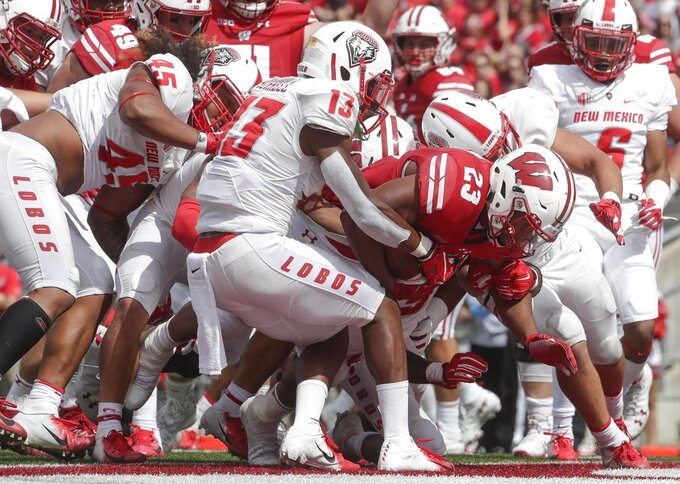 Wisconsin's Jonathan Taylor runs for a touchdown during the second half of an NCAA college football game against New Mexico Saturday, Sept. 8, 2018, in Madison, Wis. Wisconsin won 45-14. (AP Photo/Morry Gash)