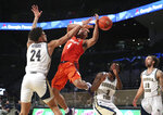 Clemson guard Nick Honor loses the ball as Georgia Tech center Rodney Howard defends during an NCAA college basketball game Wednesday, Jan. 20, 2021, in Atlanta. (Curtis Compton/Atlanta Journal Constitution via AP, Pool)