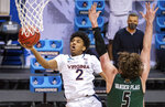Virginia guard Reece Beekman (2) shoots during the second half of a first-round game against Ohio in the NCAA men's college basketball tournament, Saturday, March 20, 2021, at Assembly Hall in Bloomington, Ind. (AP Photo/Doug McSchooler)