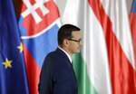 Prime Minister of Poland Mateusz Morawiecki arrives for the V4 summit at the Prague Castle, Czech Republic, Thursday, Sept. 12, 2019. (AP Photo/Petr David Josek)