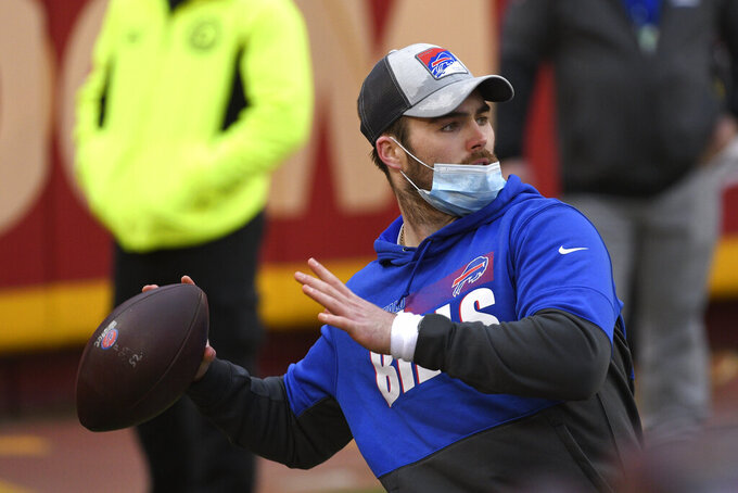 Buffalo Bills quarterback Jake Fromm warms up before the AFC championship NFL football game against the Kansas City Chiefs, Sunday, Jan. 24, 2021, in Kansas City, Mo. (AP Photo/Reed Hoffmann)
