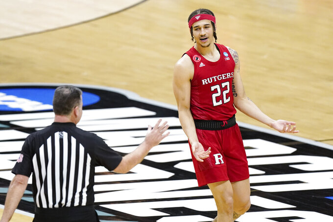Rutgers' Caleb McConnell (22) reacts to a foul call during the first half of a college basketball game between Rutgers and Houston in the second round of the NCAA tournament at Lucas Oil Stadium in Indianapolis Sunday, March 21, 2021. (AP Photo/Mark Humphrey)