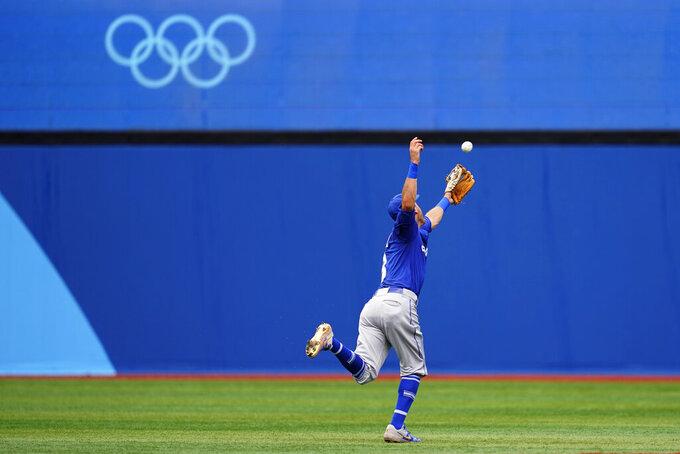 Israel's Ian Kinsler cannot reach a single during a baseball game against South Korea at Yokohama Baseball Stadium during the 2020 Summer Olympics, Monday, Aug. 2, 2021, in Yokohama, Japan. (AP Photo/Matt Slocum)