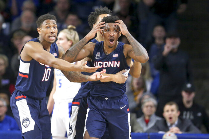 Connecticut guards Brendan Adams (10) and Christian Vital react after Vital was called for a technical foul during the team's NCAA college basketball game against Tulsa on Thursday, Feb. 6, 2020, in Tulsa, Okla. (Ian Maule/Tulsa World via AP)