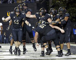 Vanderbilt tight end Cody Markel (45) celebrates after catching a 2-yard touchdown pass against Tennessee in the second half of an NCAA college football game Saturday, Nov. 24, 2018, in Nashville, Tenn. (AP Photo/Mark Humphrey)