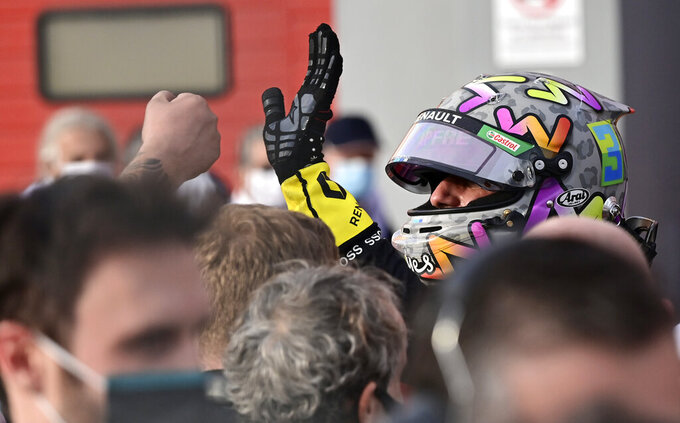 Renault driver Daniel Ricciardo of Australia is congratulated after taking third place in the Emilia Romagna Formula One Grand Prix, at the Enzo and Dino Ferrari racetrack, in Imola, Italy, Sunday, Nov.1, 2020. (Miguel Medina, Pool via AP)