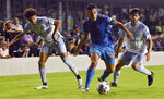 Inter Miami midfielder Victor Ulloa (13) splits the defense of D.C. United forward Adrien Perez, right, and midfielder Kevin Paredes during the first half of an MLS soccer match Saturday, May 29, 2021, in Fort Lauderdale, Fla. (AP Photo/Jim Rassol)