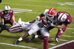 Georgia linebacker Monty Rice (32) knocks the ball from South Carolina quarterback Luke Doty (4) during the first half of an NCAA college football game Saturday, Nov. 28, 2020, in Columbia, S.C. (AP Photo/Sean Rayford)