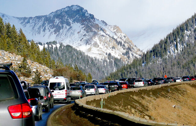 FILE - In this Jan. 7, 2018, file photo, traffic backs up on Interstate 70 near Silverthorne, Colo., Colorado transportation officials unveiled plans Wednesday for a bus system that will shuttle skiers and snowboarders from Denver to three resorts in an effort to ease traffic congestion exacerbated by a recent population boom. (AP Photo/Thomas Peipert, File)