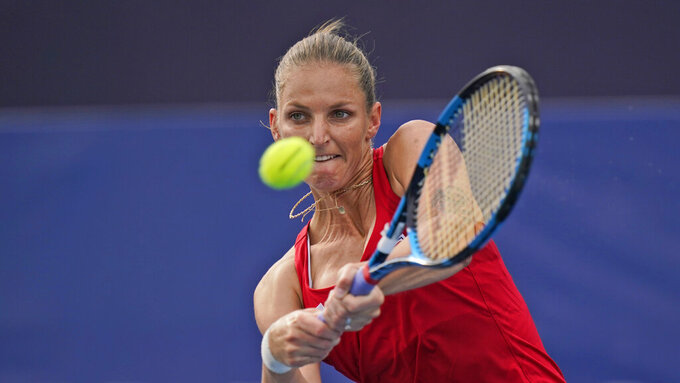 Karolina Pliskova, of the Czech Republic, plays Carla Suárez Navarro, of Spain, during the second round of the tennis competition at the 2020 Summer Olympics, Monday, July 26, 2021, in Tokyo, Japan. (AP Photo/Seth Wenig)