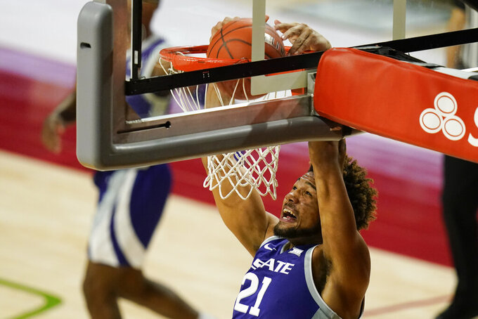 Kansas State forward David Bradford dunks the ball during the first half of an NCAA college basketball game against Iowa State, Tuesday, Dec. 15, 2020, in Ames, Iowa. (AP Photo/Charlie Neibergall)