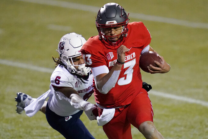 New Mexico quarterback Isaiah Chavez (13) runs by Fresno State linebacker Levelle Bailey (6) for a touchdown during the first half of an NCAA college football game Saturday, Dec. 12, 2020, in Las Vegas. (AP Photo/John Locher)