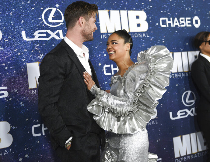 Actors Chris Hemsworth, left, and Tessa Thompson attend the world premiere of