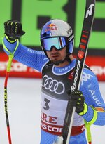Italy's Dominik Paris reacts in the finish area of the men's super-G at the alpine ski World Championships in Are, Sweden, Wednesday, Feb. 6, 2019. (AP Photo/Marco Trovati)