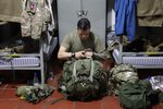 In this Jan. 25, 2020, file photo, U.S. Army Sgt. Juan Dominguez prepares his rucksack inside the barracks on Tolemaida Air Base, in Colombia. Members of the Army's 82nd Airborne Division from Fort Bragg, North Carolina, and the 3rd U.S. Infantry Regiment, which is based in D.C. and typically guards the Tomb of the Unknown Soldier, were mobilized last month to respond to massive protests over the treatment of Black Americans and systemic issues of police brutality. (AP Photo/Sarah Blake Morgan, File)