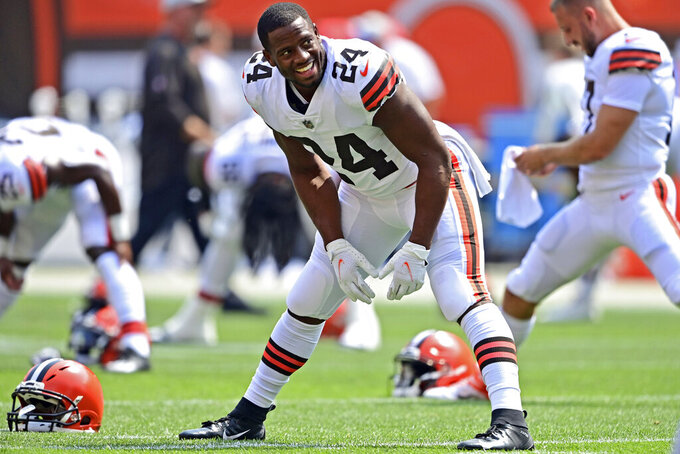 """FILE - In this Sunday, Aug. 22, 2021, file photo, Cleveland Browns running back Nick Chubb warms up before an NFL football game against the New York Giants in Cleveland. Cleveland's star running back has partnered with a charity close to his heart with the launch of """"Chubb Crunch,"""" a cereal being gobbled up by Browns fans in record numbers. (AP Photo/David Dermer, File)"""