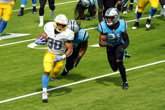 Los Angeles Chargers running back Austin Ekeler (30) runs for a touchdown past Carolina Panthers free safety Tre Boston (33) and outside linebacker Jeremy Chinn (21) during the first half of an NFL football game Sunday, Sept. 27, 2020, in Inglewood, Calif. (AP Photo/Ashley Landis )
