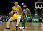 In this Feb. 7, 2019 photo, Los Angeles Lakers forward Kyle Kuzma (0) drives against Boston Celtics guard Kyrie Irving during an NBA basketball game in Boston. Kuzma is wearing Nike's latest performance basketball shoes, which from concept to reality, took about three years to put together. Or 30 years, depending on how you count. The Nike Adapt BB _ a self-lacing smart shoe that can be controlled by a smartphone _ gets released to the public on Sunday, Feb. 17, 2019, a date that just happens to coincide with the NBA All-Star Game in Charlotte. It has a motor embedded within the shoe, and a hefty $350 price tag. It has a motor embedded within the shoe, and a hefty $350 price tag. (AP Photo/Elise Amendola)