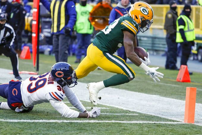 Green Bay Packers' Aaron Jones gets past Chicago Bears' Eddie Jackson for a touchdown run during the second half of an NFL football game Sunday, Dec. 15, 2019, in Green Bay, Wis. (AP Photo/Matt Ludtke)