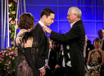 FILE - This photo provided by CBS shows Mayim Bialik, left, and Jim Parsons, center, receiving the Nobel Peace Prize in a scene from the series finale of