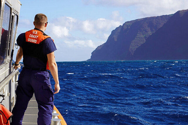 CORRECTS THE NAME OF THE PHOTOGRAPHER - In this photo released by the U.S. Coast Guard, Coast Guard Cutter William Hart moves toward the Na Pali Coast on the Hawaiian island of Kauai on Friday, Dec. 27, 2019, the day after a tour helicopter disappeared with seven people aboard. Authorities say wreckage of the helicopter has been found in a mountainous area on the island. (MK3 Forest Herring/U.S. Coast Guard via AP)