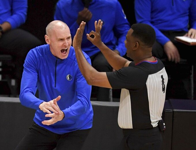 Dallas Mavericks head coach Rick Carlisle, left, reacts toward referee Sean Wright(4) after a foul call in the first half of Game 7 of an NBA basketball first-round playoff series against the Los Angeles Clippers, Sunday, June 6, 2021, in Los Angeles, Calif. (Keith Birmingham/The Orange County Register via AP)