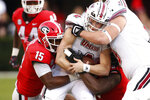 The Georgia defense stops Massachusetts quarterback Ross Comis (2) during the first half of an NCAA college football game against Massachusetts, Saturday, Nov. 17, 2018, in Athens, Ga. (Joshua L. Jones/Athens Banner-Herald via AP)