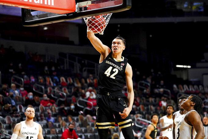 Vanderbilt forward Quentin Millora-Brown (42) dunks against Cincinnati in the first half of an NCAA college basketball game Thursday, March 4, 2021, in Cincinnati. (Kareem Elgazzar/The Cincinnati Enquirer via AP)