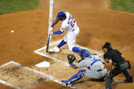 Chicago Cubs' Jason Heyward (22) swings into a two-run home run off Kansas City Royals starting pitcher Brady Singer, during the second inning of a baseball game Tuesday, Aug. 4, 2020, in Chicago. (AP Photo/Charles Rex Arbogast)