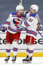 New York Rangers' Alexis Lafreniere (13) celebrates with teammate Adam Fox (23) after scoring against the New York Islanders during the second period of an NHL hockey game Friday, April 9, 2021, in Uniondale, N.Y. (AP Photo/Jason DeCrow)