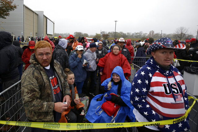 Kyle Terry, 33, front left, stands at the head of the line of supporters waiting to attend a campaign rally for President Donald Trump at Lancaster Airport, Monday, Oct. 26, 2020 in Lititz, Pa. Cynthia Reidler is seen in background. (AP Photo/Jacqueline Larma)