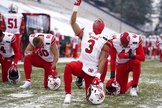 Utah running back Micah Bernard gestures after joining in a moment of silence with teammates before taking on Colorado in an NCAA college football game Saturday, Dec. 12, 2020, in Boulder, Colo. (AP Photo/David Zalubowski)