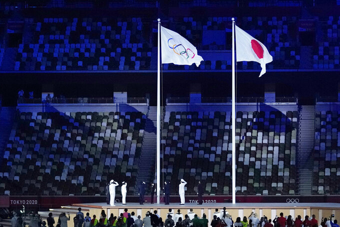 The Olympic flag is raised during the opening ceremony in the Olympic Stadium at the 2020 Summer Olympics, Friday, July 23, 2021, in Tokyo, Japan. (AP Photo/Kirsty Wigglesworth)