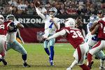 Dallas Cowboys quarterback Ben DiNucci (7) throws against the Arizona Cardinals during the second half of an NFL preseason football game, Friday, Aug. 13, 2021, in Glendale, Ariz. (AP Photo/Rick Scuteri)