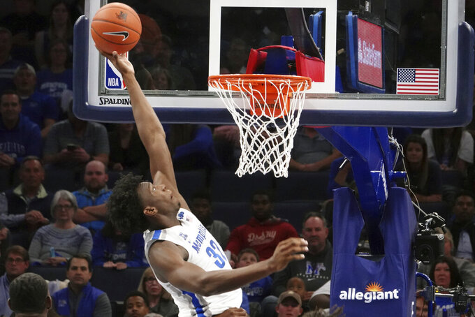 Memphis' James Wiseman (32) dunks against South Carolina State during the first half of an NCAA college basketball game Tuesday, Nov. 5, 2019, in Memphis, Tenn. (AP Photo/Karen Pulfer Focht)