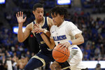 Saint Louis' Yuri Collins, right, heads to the basket past George Washington's Armel Potter during the second half of an NCAA college basketball game Wednesday, Jan. 8, 2020, in St. Louis. (AP Photo/Jeff Roberson)