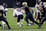 Chicago Bears quarterback Mitchell Trubisky (10) is sacked by New Orleans Saints defensive tackle Sheldon Rankins (98) in the second half of an NFL wild-card playoff football game in New Orleans, Sunday, Jan. 10, 2021. (AP Photo/Brett Duke)