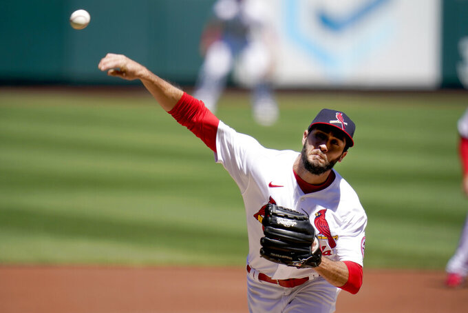 St. Louis Cardinals starting pitcher Daniel Ponce de Leon throws during the first inning of a baseball game against the Milwaukee Brewers Sunday, April 11, 2021, in St. Louis. (AP Photo/Jeff Roberson)