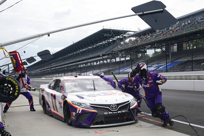 Denny Hamlin makes a pit stop during a NASCAR Series auto race at Indianapolis Motor Speedway, Sunday, Aug. 15, 2021, in Indianapolis. (AP Photo/Darron Cummings)