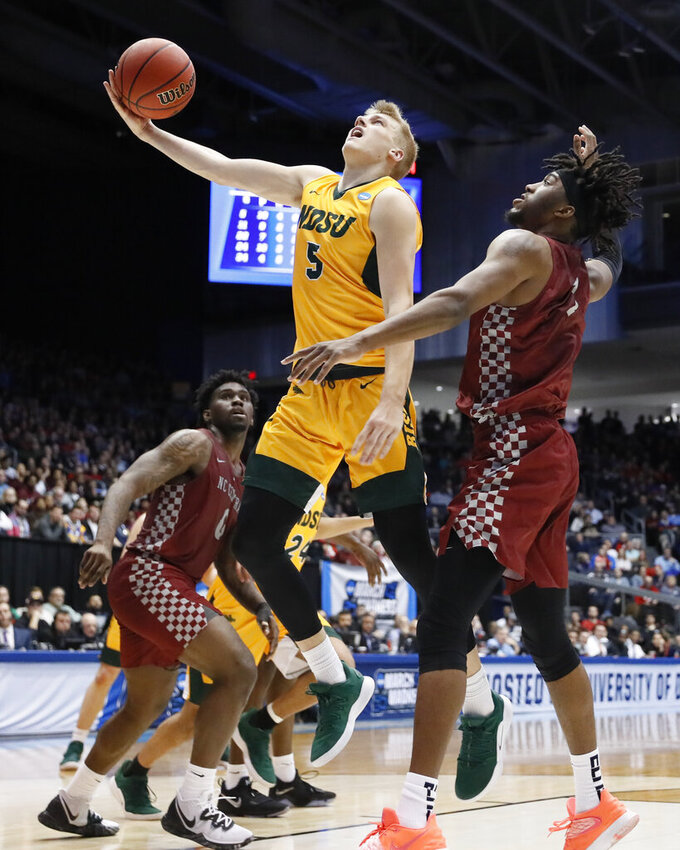 North Dakota State's Sam Griesel (5) shoots in front North Carolina Central's Zacarry Douglas, right, during the second half of a First Four game of the NCAA men's college basketball tournament Wednesday, March 20, 2019, in Dayton, Ohio. (AP Photo/John Minchillo)