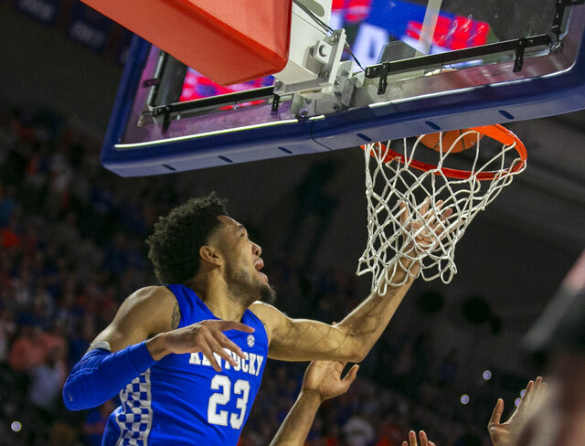 Kentucky forward EJ Montgomery (23) tips in the winning basket late in the second half of an NCAA college basketball game Saturday, March 7, 2020, in Gainesville, Fla. Kentucky won 71-70. (AP Photo/Alan Youngblood)