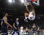 New York Knicks' DeAndre Jordan (6) dunks in front of Minnesota Timberwolves' Taj Gibson (67) and Derrick Rose, left, during the second half of an NBA basketball game Friday, Feb. 22, 2019, in New York. The Timberwolves won 115-104. (AP Photo/Frank Franklin II)