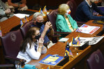 Guests listen during a public hearing on the redistricting plan at the Statehouse, Thursday, Sept. 16, 2021, in Indianapolis. (AP Photo/Darron Cummings)