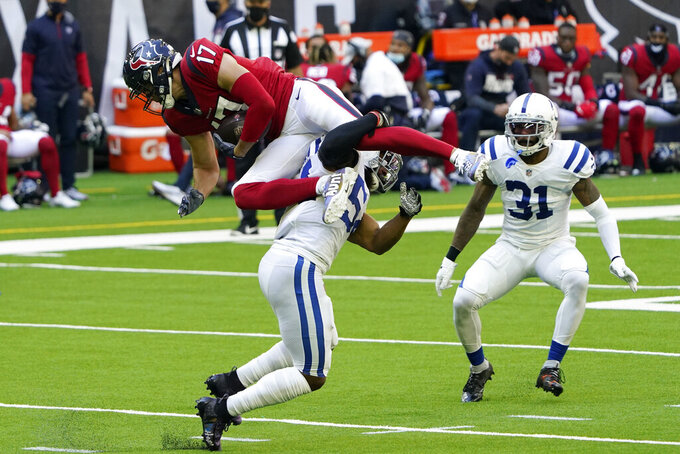 Houston Texans wide receiver Chad Hansen (17) is hit by Indianapolis Colts middle linebacker Anthony Walker (54) after a catch during the first half of an NFL football game Sunday, Dec. 6, 2020, in Houston. (AP Photo/David J. Phillip)
