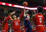 Texas Tech's Davide Moretti (25) and TCU's Ruseel Barlow (34) try to rebound the ball during the first half of an NCAA college basketball game Monday, Jan. 28, 2019, in Lubbock, Texas. (AP Photo/Brad Tollefson)