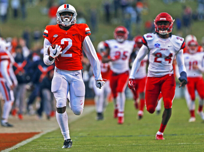FILE - In this Nov. 10, 2018, file photo, Virginia's Joe Reed (2) breaks away for a touchdown on the opening kickoff in the second half of an NCAA college football game against Liberty, in Charlottesville, Va. As the start of fall practice approaches, the Cavaliers have to identify the playmakers most likely to fill the voids left by the graduations of Olamide Zaccheaus and Jordan Ellis. Enter Hasise Dubois and Joe Reed, the top returning receivers from a year ago. (Zack Wajsgras/The Daily Progress via AP, File)