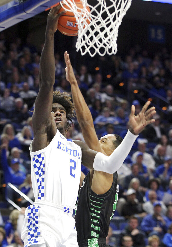 Kentucky's Kahlil Whitney, left, shoots while defended by Utah Valley's Jamison Overton during the second half of an NCAA college basketball game in Lexington, Ky., Monday, Nov. 18, 2019. (AP Photo/James Crisp)