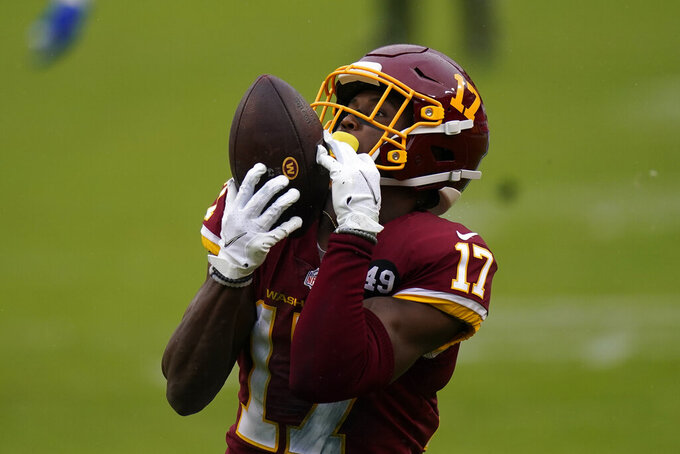 Washington Football Team wide receiver Terry McLaurin (17) catches a pass from quarterback Kyle Allen (8) for a touchdown against Dallas Cowboys in the first half of an NFL football game, Sunday, Oct. 25, 2020, in Landover, Md. (AP Photo/Patrick Semansky)