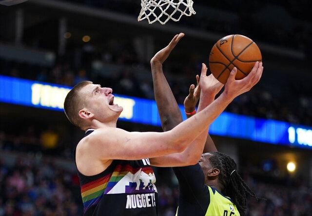 Denver Nuggets center Nikola Jokic (15) goes up for a shot against Minnesota Timberwolves center Naz Reid (11) during the third quarter of an NBA basketball game Sunday, Feb. 23, 2020, in Denver (AP Photo/Jack Dempsey)